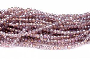Fasetterade glaspärlor Lila AB 6mm