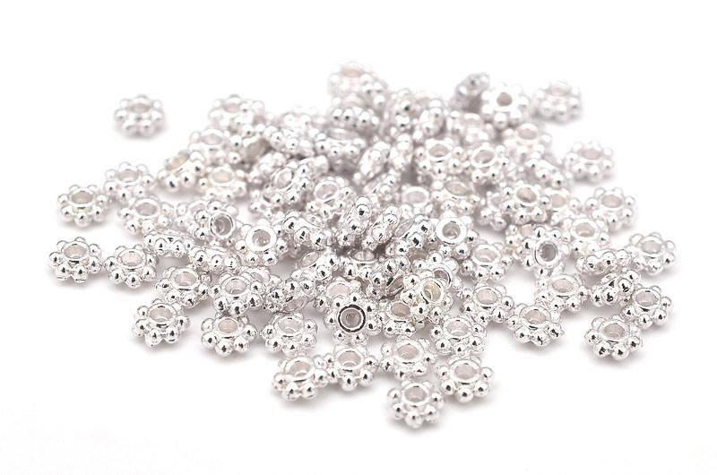 Silverpläterade små kugghjul