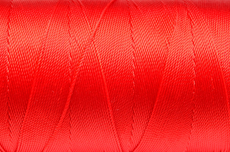 Tvinnad nylontråd 0,6mm Röd