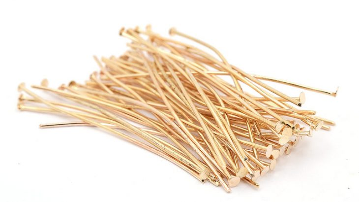 Ljust guldpläterade hattpinnar 50 mm