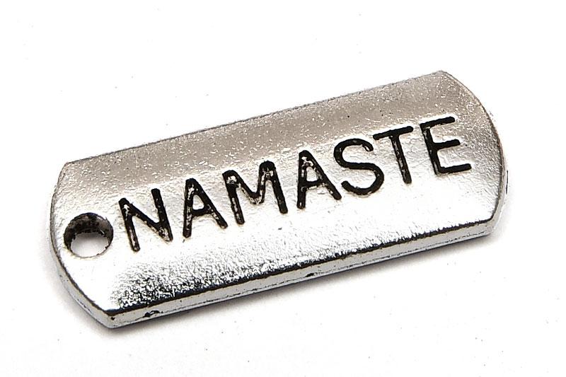 Antiksilver budskapsberlock, NAMASTE