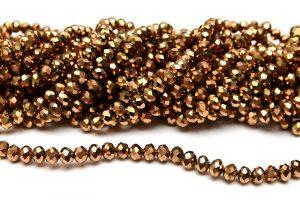 Fasetterade glaspärlor Metallic guld 6x4mm