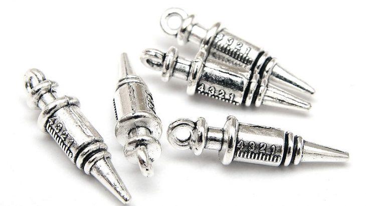 Antiksilver berlocker Vaccin spruta