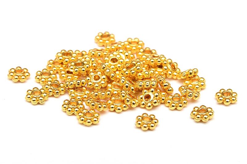 Guldpläterade små kugghjul